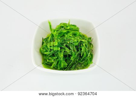 Salad With Seaweed With Sauce And Sesame Seeds Isolate On White Background