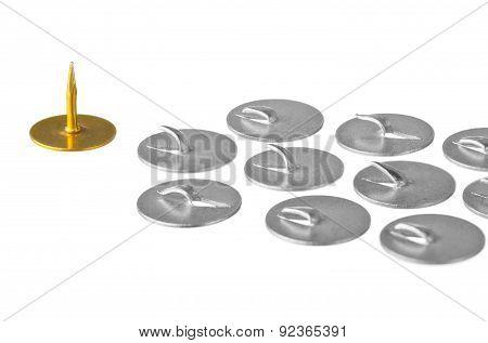 Golden thumbtack at the head troop of iron thumbtacks