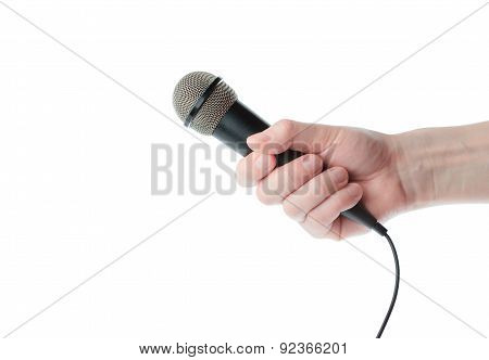 Microphone in male hand on a white background