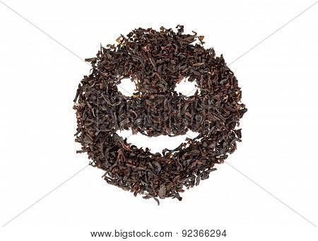 Black tea in the form of a smiling face