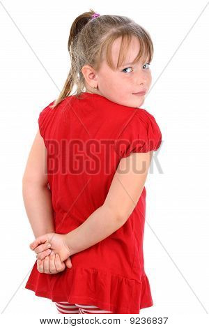 Small girl dressed in red looking over her shoulder isolated on white