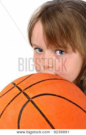 Small girl with blond hair holding basketball isolated on white