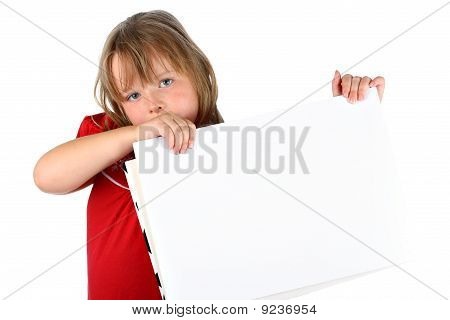 Small girl carrying a blank paper with room for text isolated on white