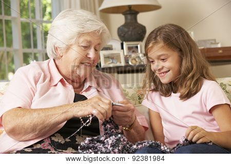 Grandmother Showing Granddaughter How To Knit At Home