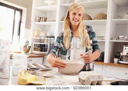 Young girl baking at home