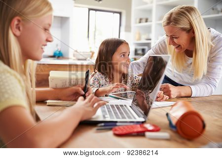 Mother spending time with daughters at home