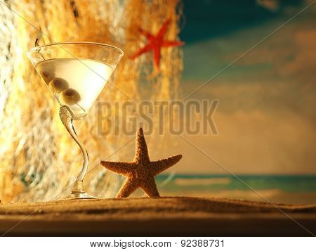 Martini cocktail at the sandy beach