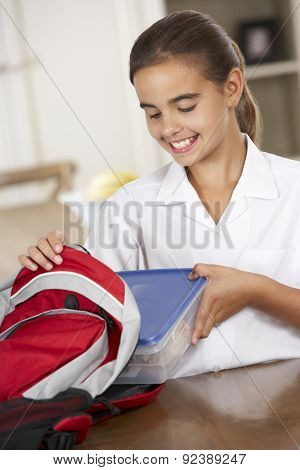 Schoolgirl With Healthy Lunchbox In Kitchen