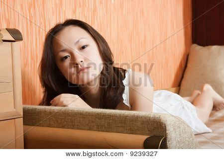 Stilish Asian Girl On Sofa