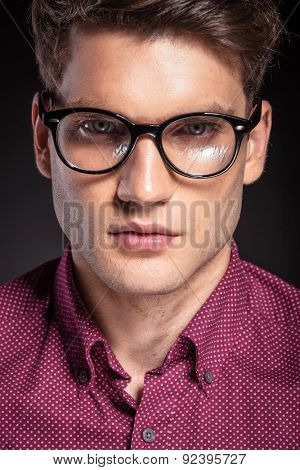 Portrait of a casual handsome man wearing glasses.