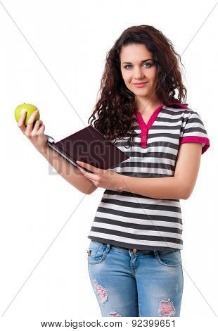 Beautiful teen girl with books and apple posing on white background