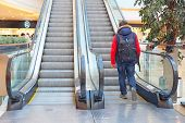 stock photo of escalator  - The man on the escalator at the mall - JPG