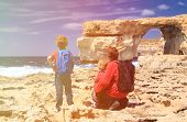 pic of gozo  - father and kids looking at Azure Window on Gozo island - JPG