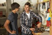 image of workbench  - Father Teaching Son To Use Workbench In Garage - JPG