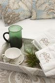 image of bed breakfast  - Breakfast ready to be served over a bed with towels - JPG