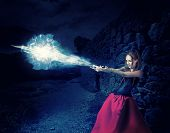 image of witch ball  - beautiful woman witch trains in medieval castle cast magic  - JPG