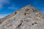 image of ling  - looking up ha ling mountain in canada with lots of people on it and blue sky - JPG