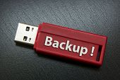 "foto of memory stick  - ""Backup"" Writing On A Red Usb Memory Stick - JPG"
