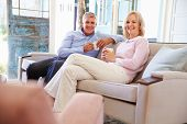image of hot couple  - Mature Couple At Home Relaxing In Lounge With Hot Drink - JPG