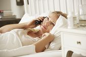 pic of people talking phone  - Sick Woman In Bed At Home Talking On Phone - JPG