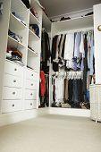 stock photo of wardrobe  - Tidy Teenage Bedroom With Neat Wardrobe - JPG