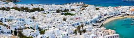 stock photo of greek-island  - Traditional greek village with white houses on Mykonos Island - JPG