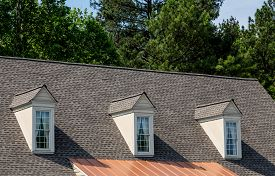 image of shingles  - Three white wood dormers on an old grey shingle roof - JPG