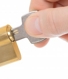 picture of insert  - Hand inserting keys in lock on a white background - JPG