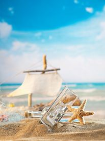 stock photo of ouzo  - Traditional Greek ouzo at the beach - JPG