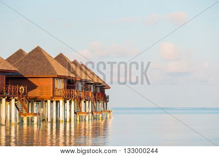 Water villas Bungalows on ideal perfect tropical island, Maldives