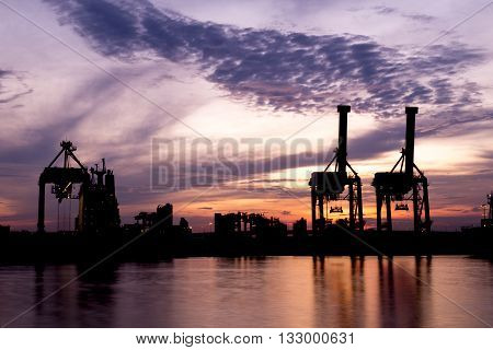 Silhouette Of A Shipping Port In Morning.
