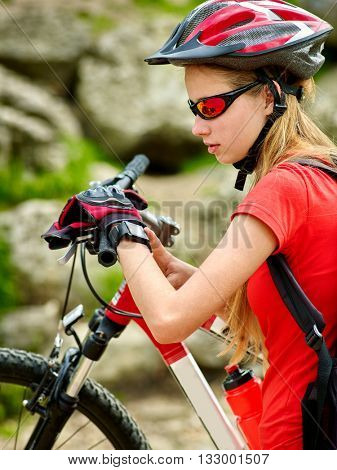 Bikes cycling girl. Bicyclist girl watch on smart watch. Sammer outdoor.