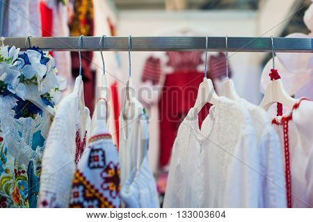 National ukrainian clothes hanging in the closet on trempel.