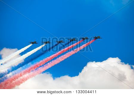 MOSCOW, RUSSIA - MAY 7, 2016: Avia parade in Moscow. Group of Russian fighters Sukhoi Su-25 with painted russian flag in the sky on parade of Victory in World War II in Moscow, Russia