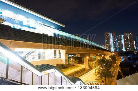Light trails from vehicles on highway and train station
