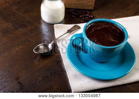 Cup Of Coffee With Cofee Beans And Milk