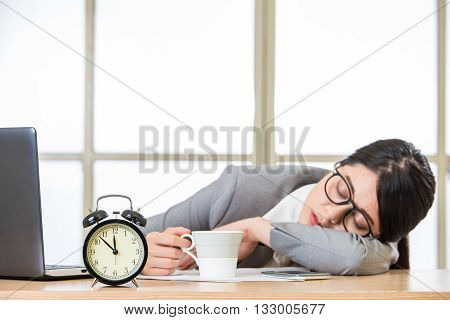 Tired Woman Are Sleeping And Holding Coffee