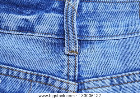 Blue jeans with back pockets .Denim jeans texture or denim jeans background with old torn. Old grunge vintage denim jeans. Stitched texture denim jeans background of fashion jeans design. Dark edged.