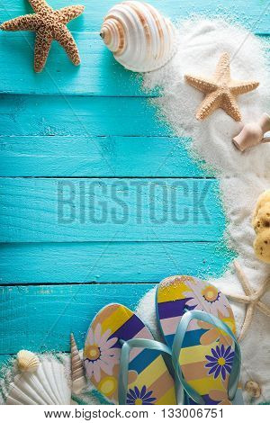 Summer background. Wooden background with white sand and seashells.Shells starfish and sand. Holiday background