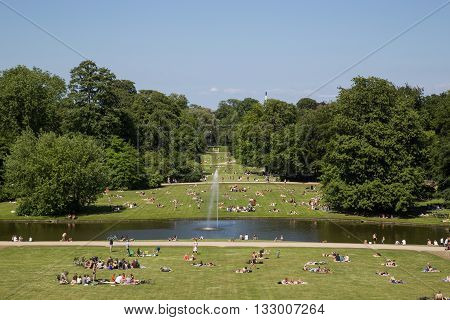 Frederiksberg, Denmark - June 5, 2016: People enjoying the sunshine in Frederiksberg park on a Sunday afternoon.