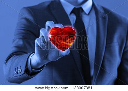 Businessman holding red heart in medical concept