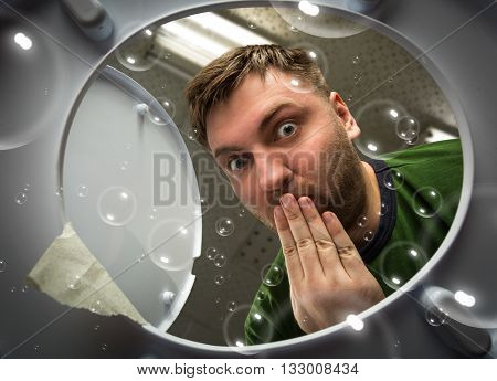 Man looking in the toilet bowl