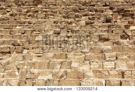 Rows of big yellow stones at the Great Pyramids in Egypt