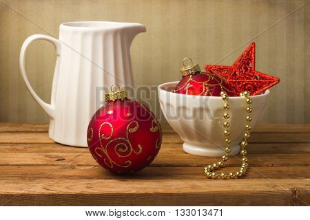 Still life with jar and Christmas ornaments