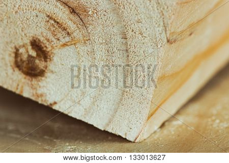 Planed board a block and a little sawdust on a wooden surface in the carpentry workshop