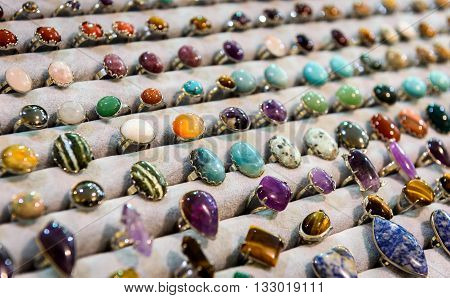Display With Different Design Of Handmade Rings With Stones Gems