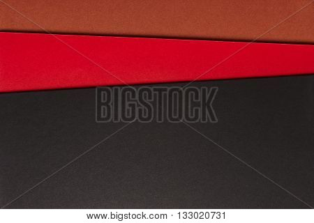 Colored cardboards background in black red brown tone. Copy space. Horizontal
