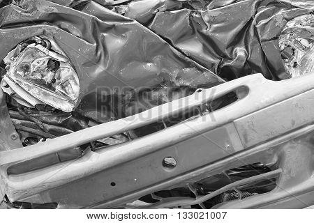 Vehicle scrap detail. Metallic parts and light. Horizontal format