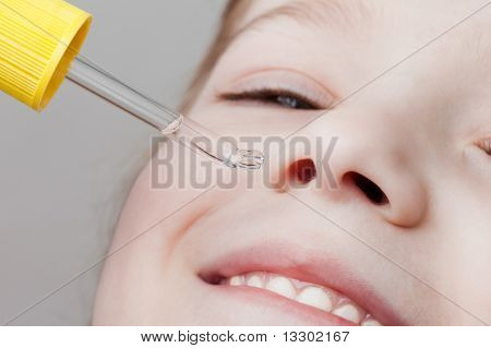 Applying Nasal Dropper