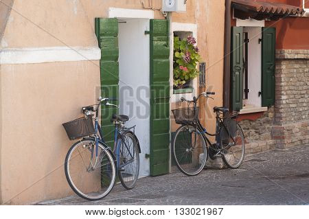Two Bicycle on a street in Italy (Caorle). Summer 2014.